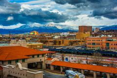 View of distant mountains and Alvarado Transportation Center in Albuquerque,  - stock photo