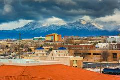 View of distant mountains and buildings in Albuquerque, New Mexico. - stock photo