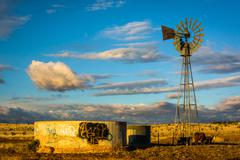 Windmill on a farm near Albuquerque, New Mexico. - stock photo