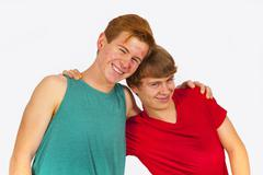 brothers make jokes together and have fun together - stock photo