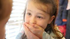 Little girl wiggling loose tooth. - stock footage