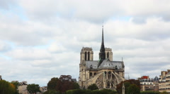 Notre Dame de Paris cathedral on a cloudy day Stock Footage