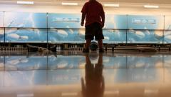 Low view kid bowling Stock Footage