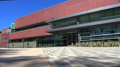 Traveling establishing shot of the exterior of a generic modern office building. Stock Footage