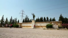 People near monument to the Battle of Thermopylae and statue of Leonidas, Greece - stock footage