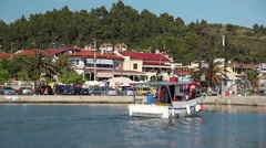 Cars and boats in harbour in Nea Skioni village in Greece Stock Footage