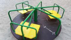 Merry-go-round on childrens playground Stock Footage