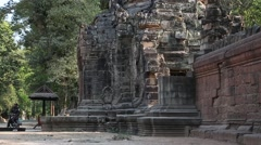 Bas-relief of the face on ancient wall in Angkor Thom temple complex, Cambodia Stock Footage