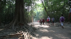 People in the area of Angkor Thom temple complex in Cambodia Stock Footage