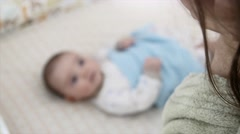 Mother and her newborn infant in a crib - stock footage