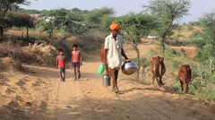 Video 1920x1080 Indian boys and man go to fetch water in the desert , Pushkar Stock Footage