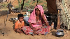 Indian woman and child attended the annual Pushkar Camel Mela Stock Footage