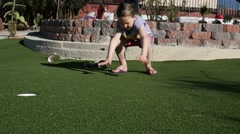 slow motion girl jumps off mini golf wall - stock footage