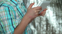 Boy listening music through headphones using a tablet PC Stock Footage
