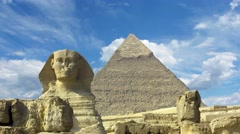 Clouds over great pyramid and sphinx in Egypt - timelapse 4k - stock footage