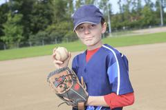 A child baseball pitchen on the field Stock Photos