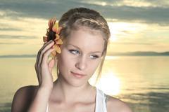 Summer joy with sunflower on the ear - stock photo