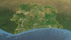 Glide over the satellite map of Côte d'Ivoire outlined Stock Footage