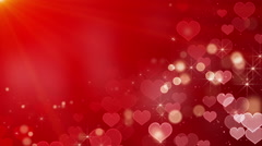 Heart shape bokeh lights and stars loop Stock Footage