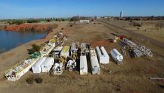 Drilling Rig grave yard Aerial 3 Stock Footage