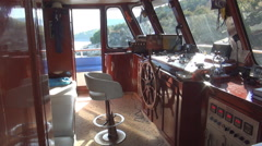 Steering of a ship, wheelhouse, tourist boat seen from inside. Stock Footage