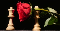 3104 King Giving Queen a Red Rose Chess Pieces, 4K Stock Footage
