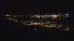 Landscape with harbor by night. Port on island lit up at night. Stock Footage