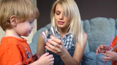Mom gives kids twins drink clean water - stock footage