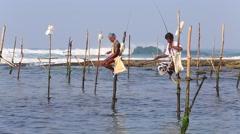 Video 1920x1080  Fishermen are fishing in sea in unique style. Sri Lanka Stock Footage
