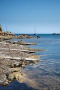 Landscape image of old Mediteranean fishing village in Ibiza - stock photo