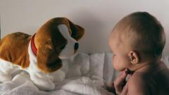 Baby and toy tumbler - stock footage