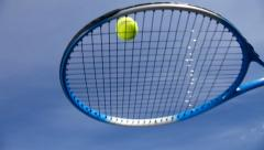 tennis racket hitting a tennis ball - stock footage