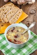 Sour soup with bread. Stock Photos