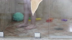 Toddler in the shower with his mother Stock Footage