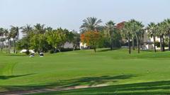 Perfect golf resort in Dubai city, golf carts Stock Footage