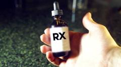 RX bottle dropper drug Stock Footage