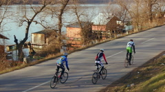 Aerial shot bicycle riders chase view mixed shot Stock Footage