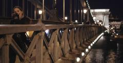 A young girl walking over The Chain Bridge - Cinema 4K - stock footage