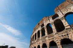 Famous colosseum on bright summer day - stock photo