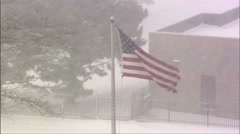 US Flag Waving in a Winter Snow Storm Stock Footage