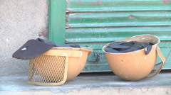 Casques lying on the ground at Srinagar in Jammu and Kashmir, India Stock Footage