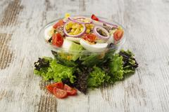 Fresh prepared salad in a bowl to take - stock photo