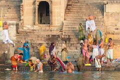 Pilgrims Bathing in the Ganges River in Varanasi, Uttar Pradesh, India Stock Photos