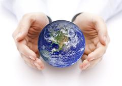 Earth in hands. Earth image provided by Nasa. Stock Photos