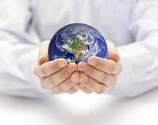 Earth in hands. Earth image provided by Nasa. - stock photo