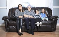Portrait of smiling multigeneration family spending leisure time - stock photo