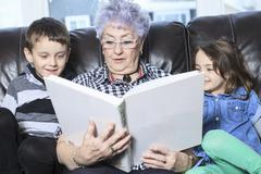 Portrait of smiling multigeneration family spending leisure time - stock photo