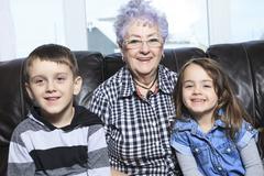 Portrait of smiling multigeneration family spending leisure time Stock Photos