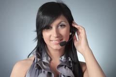 Young female customer service representative in headset Kuvituskuvat