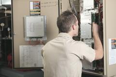 A Air Conditioner Repair Man at work Stock Photos